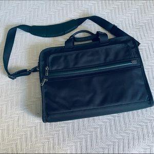 Tumi black computer bag with shoulder strap